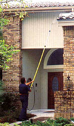 Stripping paint with an extension wand equiped pressure cleaner